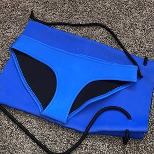 Triangl swimsuit bottom and bag